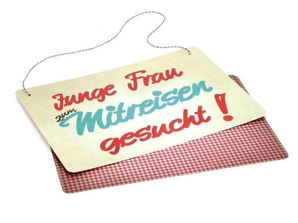 Schild JUNGE FRAU ZUM MITREISEN GESUCHT!