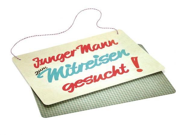 Schild JUNGER MANN ZUM MITREISEN GESUCHT!